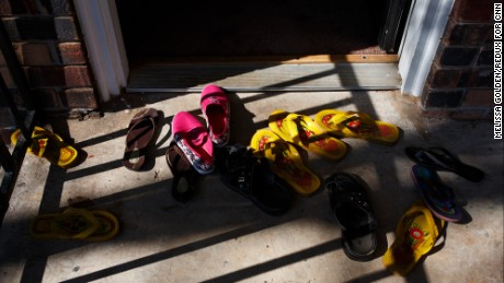 Abdalla and his family leave their shoes outside their apartment in Clarkston, Georgia. Today, they've left the door ajar to let in the breeze. But on some days when a stranger knocks, they're still scared to open it.