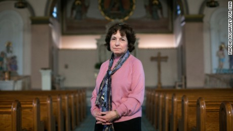 Gail Francioli stands in the Holy Rosary Church in Cleveland after mass on Sunday, February 19. She struggled with her vote but wanted a president who would appoint conservatives to the Supreme Court.