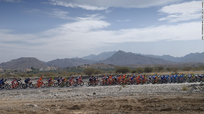 The peloton rides during the first stage of the 8th edition of the cycling Tour of Oman between al-Sawadi Beach and Naseem Park on February 14, 2017 in Manumah.