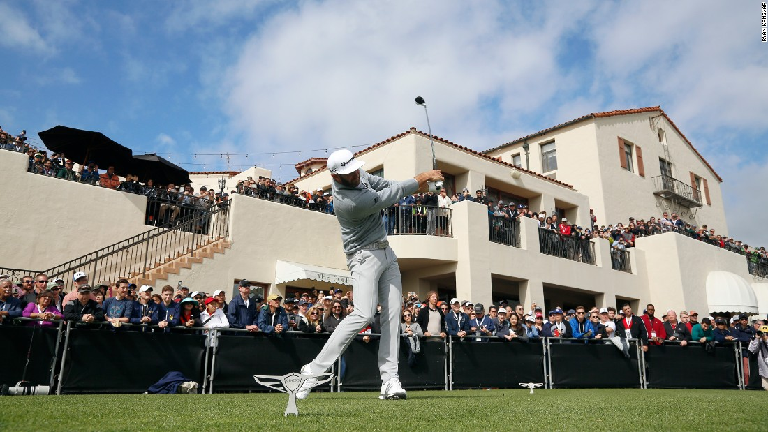"Golf fans watch Dustin Johnson tee off during the final round of the Genesis Open in Los Angeles on Sunday, February 19. Johnson won the tournament by five shots and <a href=""http://www.cnn.com/2017/02/20/golf/golf-dustin-johnson-world-number-one/index.html"" target=""_blank"">moved to No. 1</a> in the World Golf Rankings."