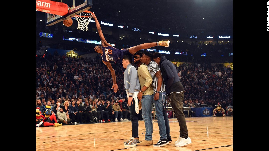 Derrick Jones Jr. tries to dunk over some of his Phoenix Suns teammates during the NBA's Slam Dunk Contest on Saturday, February 18. Jones finished in second behind Glenn Robinson III.