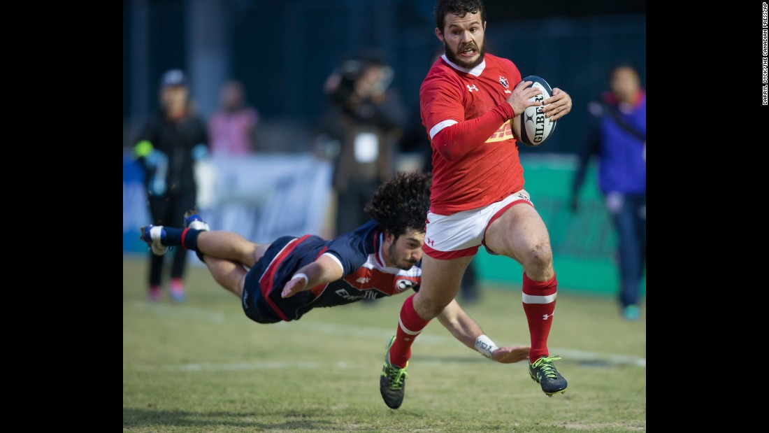 Canada's Taylor Paris outruns American Ryan Matyas to score a try during the Americas Rugby Championship on Saturday, February 18. The United States won the match 51-34 in Burnaby, British Columbia.
