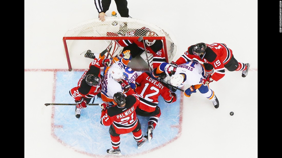 New Jersey goalie Cory Schneider is knocked into his own net during an NHL game against the New York Islanders on Saturday, February 18.