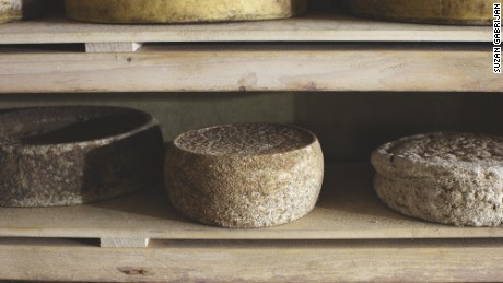 Ana Roš and partner Valter Kramar age rounds of local Tolminc cheese for up to seven years.
