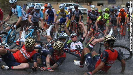 Riders fall to the ground during the Tour of Oman's fifth stage.