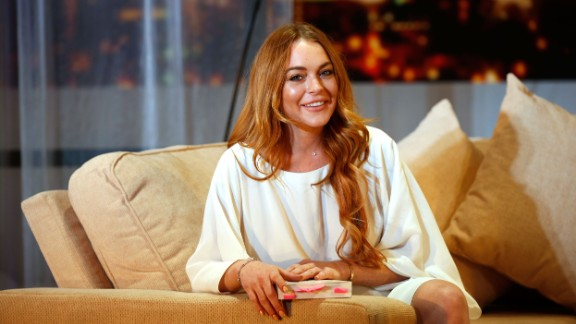 "LONDON, ENGLAND - Lindsay Lohan attends a photocall for ""Speed The Plow"" at Playhouse Theatre on September 30, 2014. (Photo by Tim P. Whitby/Getty Images)"