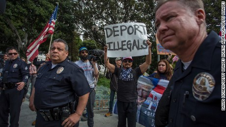 LOS ANGELES, CA - FEBRUARY 18: A small group of Trump supporters confronts marchers during the Immigrants Make America Great March to protest actions being taken by the Trump administration on February 18, 2017 in Los Angeles, California. Protesters are calling for an end to stepped up ICE raids and deportations, and that health care be provided for documented and undocumented people. (Photo by David McNew/Getty Images)