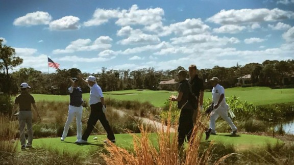 President Donald Trump plays golf with Japanese Prime Minister Shinzo Abe.