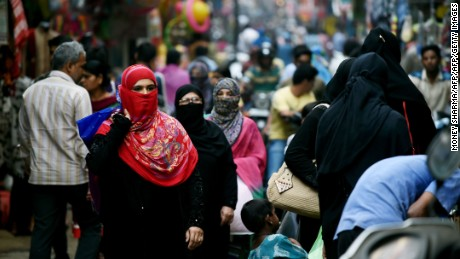 In this photograph taken on April 28, 2016, Muslim shoppers walk through a market in Bhopal.
