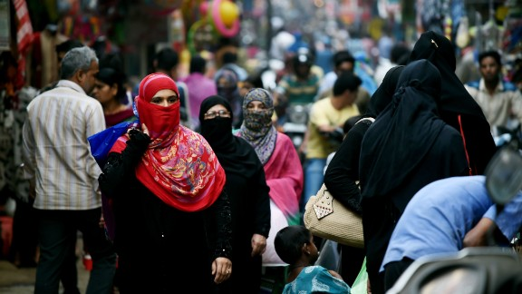 """In this photograph taken on April 28, 2016, Muslim shoppers walk through a market in Bhopal. Only three words were scrawled on the letter from her husband and posted to her parent's home in central India, but they were enough to shatter Sadaf Mehmood's life. Using an ancient and controversial Islamic practice, Mehmood's husband wrote """"talaq, talaq, talaq"""" or """"I divorce you"""" three times in Arabic, instantly ending his marriage of five years.  / AFP / MONEY SHARMA / TO GO WITH INDIA-MARRIAGE-RELIGION-WOMEN-RIGHTS, FEATURE BY JALEES ANDRABI        (Photo credit should read MONEY SHARMA/AFP/Getty Images)"""