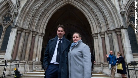 Charles Keidan and Rebecca Steinfeld outside the High Court in London.