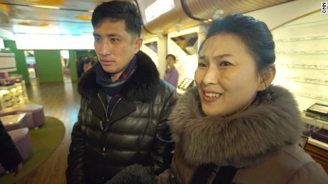 "North Korean housewife Kim Chun Ae, standing with her husband Kim Chol Ryong, says she is not the ""slightest"" bit interested in who is US president."