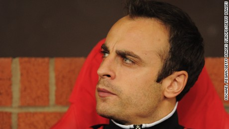 MANCHESTER, ENGLAND - SEPTEMBER 27:  Dimitar Berbatov of Manchester United looks thoughtful as he sits on the bench prior to the UEFA Champions League Group C match between Manchester United and FC Basel at Old Trafford on September 27, 2011 in Manchester, England.  (Photo by Michael Regan/Getty Images)