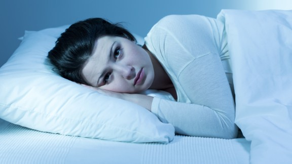"""Plagued by insomnia? Or just not fitting in enough Z's? You're not alone. The vast majority of Americans is officially sleep-deprived. <a href=""""http://www.mayoclinic.org/healthy-lifestyle/adult-health/expert-answers/sleep-and-weight-gain/faq-20058198"""" target=""""_blank"""" target=""""_blank"""">Studies </a>have shown that sleeping fewer than five or more than nine hours a night can pack on the pounds. Mostly that's because you're more likely to reach for high-calorie snacks and do less exercise."""