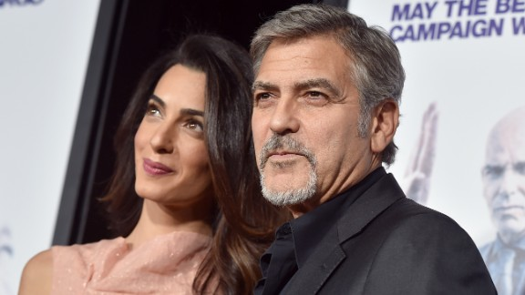 HOLLYWOOD, CA - OCTOBER 26:  Amal Alamuddin (L) and actor George Clooney attend the premiere of Warner Bros. Pictures