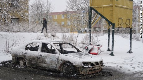Police say 10 cars were set alight during riots in the Stockholm suburb of Rinkeby.