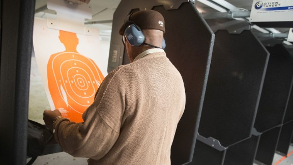 A man practices his marksmanship skills at the Metro Shooting Supplies range in 2014 in a suburban St. Louis store near Ferguson, Missouri.
