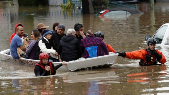Rescue crews steer a boat full of residents in a flooded San Jose, California, neighborhood on Tuesday, February 21. One of Southern California's most powerful storms in recent years has caused flooding, power outages and blackouts across the region.