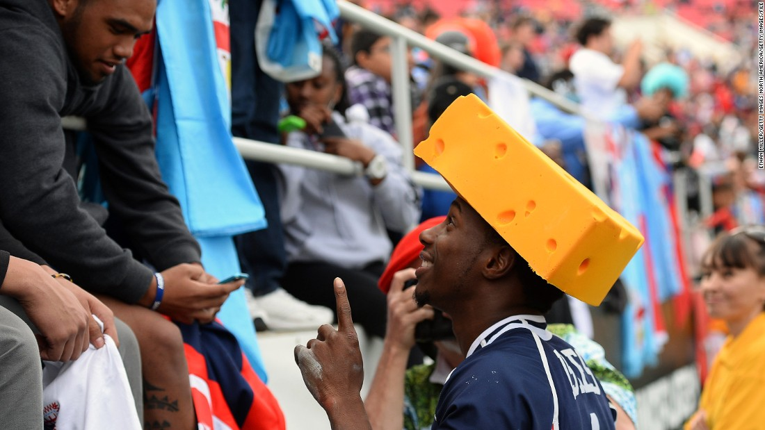 US speedster Carlin Isles, who bagged a try in the 2018 final, is popular with the home supporters. Here he wears a cheese hat at the request of a fan taking his photo after a 2014 game.