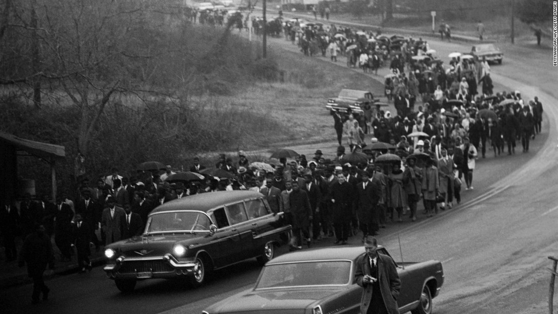 A hearse carries the body of Jimmie Lee Jackson, a black deacon and civil rights activist who was shot by a state trooper during a voting rights march in Marion, Alabama, in February 1965. Jackson's death was a catalyst for the first Selma-Montgomery march.