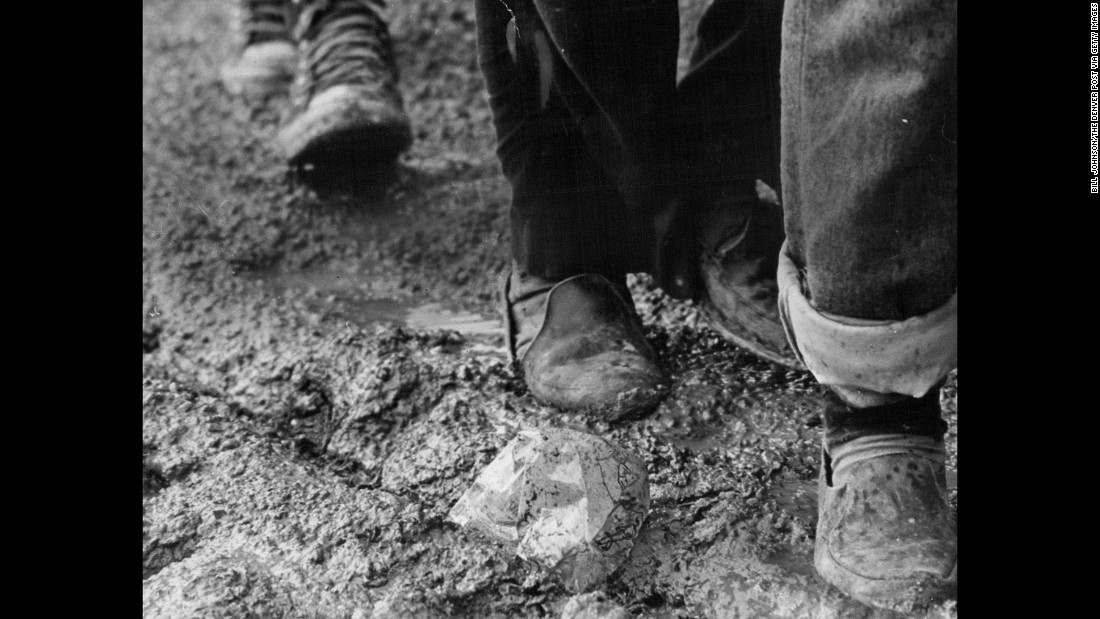 Marchers walk through mud. The protest had grown to about 25,000 people by the time it reached Montgomery.