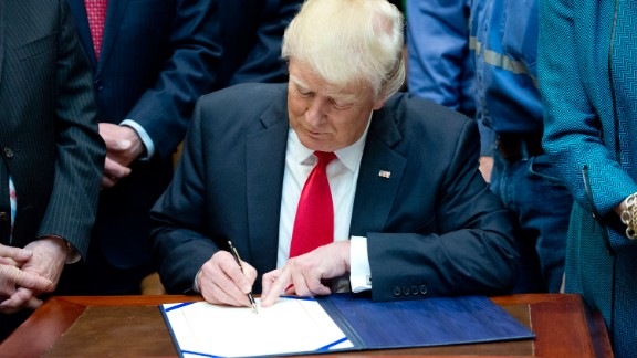 WASHINGTON, DC - FEBRUARY 16:  U.S. President Donald Trump signs H.J. Res. 38, disapproving the rule submitted by the US Department of the Interior known as the Stream Protection Rule in the Roosevelt Room of the White House on February 16, 2017 in Washington, DC.  The Department of Interior