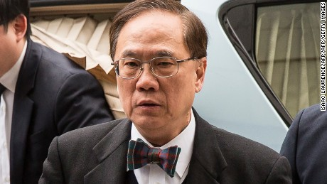 Former Hong Kong leader Donald Tsang, in his iconic bow-tie, arrives at the High Court Wednesday.