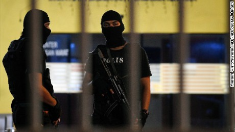 Royal Malaysian Police Special Forces personnel stand guard inside the compound of the forensic wing at Hospital Kuala Lumpur in the early hours of Tuesday, where the body of a North Korean man suspected to be Kim Jong Nam, the estranged half-brother of North Korean leader Kim Jong Un, is being kept.