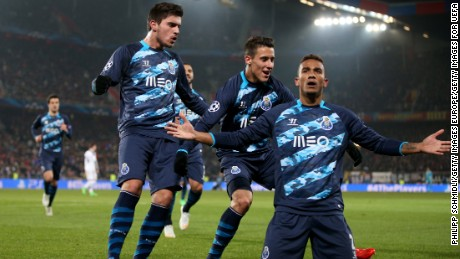 BASEL, SWITZERLAND - FEBRUARY 18: Danilo (R) of FC Porto celebrates with teammates after scoring his team's first goal during the UEFA Champions League Round of 16 match between FC Basel 1893 and FC Porto at St. Jakob-Park on February 18, 2015 in Basel, Switzerland. (Photo by Philipp Schmidli/Getty Images for UEFA)