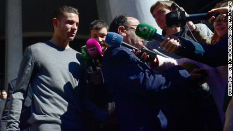 Atletico Madrid's French defender Lucas Hernandez (L) leaves the Madrid's Criminal Court Nr. 35, which specialises in domestic violence, on February 21, 2017.  Lucas Hernandez and his girlfriend were summoned today to court in Madrid. The couple must be tried for alleged domestic violence after a nightly altercation between them which earned the player some hours of custody on February 3, 2017. / AFP / PIERRE-PHILIPPE MARCOU        (Photo credit should read PIERRE-PHILIPPE MARCOU/AFP/Getty Images)
