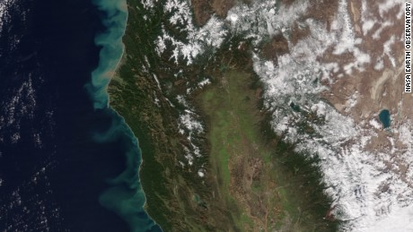 A NASA satellite photo show how California's rains have dumped sediment into the Pacific Ocean.