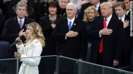 Jackie Evancho performs the National Anthem as Vice President Mike Pence and President Donald Trump watch on the West Front of the U.S. Capitol on January 20, 2017 in Washington, DC.