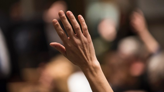 A constituent of Minnesota's 6th District raises their hand to ask a question of Rep Tom Emmer (R-MN) at a town hall meeting on February 22, 2017 in Sartell, Minnesota.