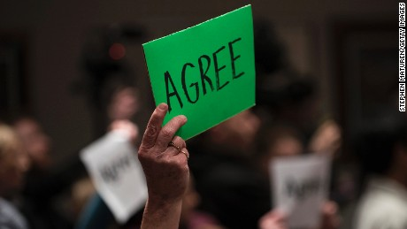 "A constituent holds up sign which reads ""Agree"" during a town hall meeting with Rep Tom Emmer (R-MN) on February 22, 2017 in Sartell, Minnesota."