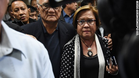 Security personnel escort Sen. Leila de Lima to a press conference Thursday in the Philippines Senate.