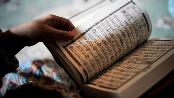 A young Bahraini Shiite Muslim girl reads the Quran