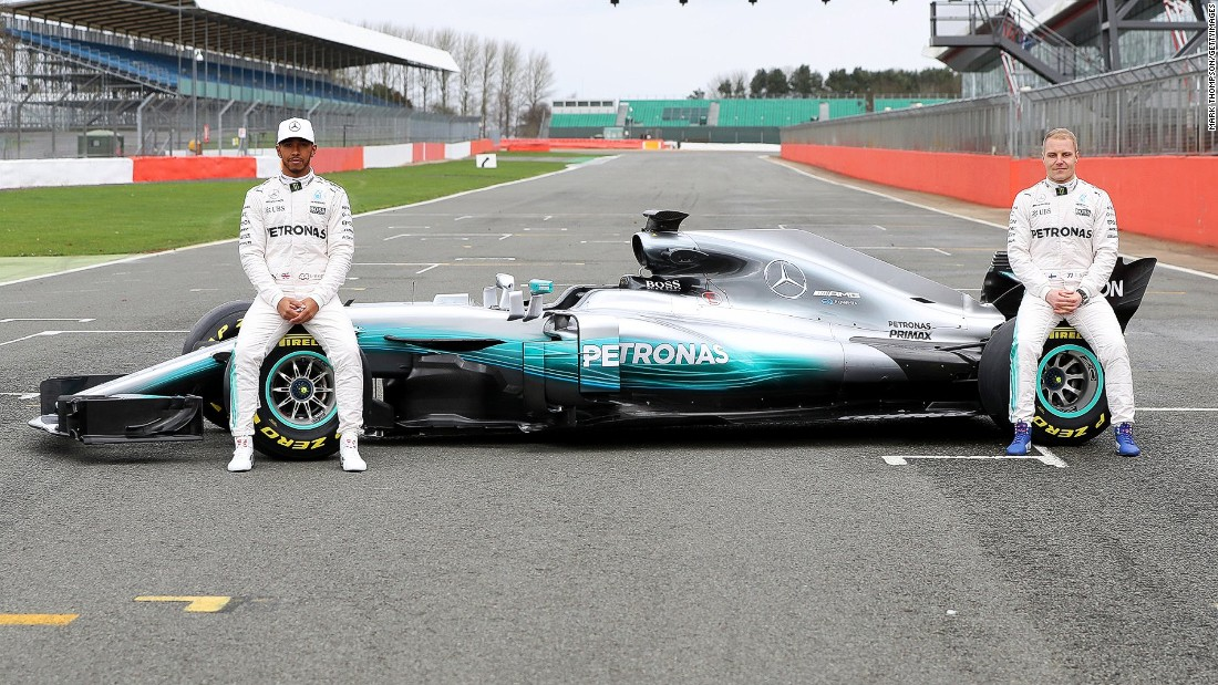 Lewis Hamilton and Valtteri Bottas pose with the Mercedes W08 -- the car the dominant German team hopes will fuel further success in Formula One.