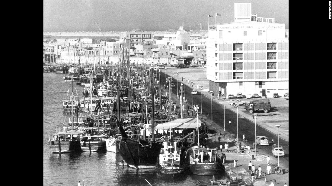 In 1971, Dubai became a founding member of the United Arab Emirates. Pictured, Dubai Creek crowded with dhows. On the right is the National Bank of Dubai.