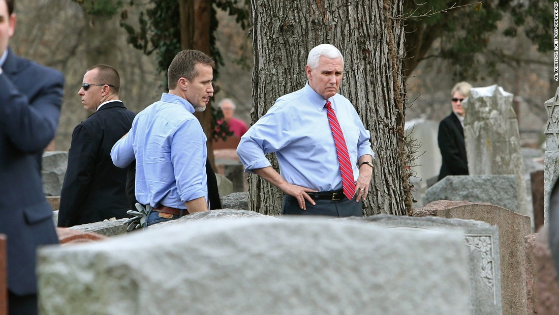 "Missouri Gov. Eric Greitens, center left, and Vice President Mike Pence help cleanup efforts Wednesday, February 22, at the Chesed Shel Emeth Society cemetery in University City, Missouri. More than 100 grave markers <a href=""http://www.cnn.com/2017/02/22/politics/jewish-cemetery-muslims-fundraising-trnd/"" target=""_blank"">at the Jewish cemetery were vandalized,</a> police said. The vandalism report came on a day the White House <a href=""http://www.cnn.com/2017/02/20/politics/white-house-denounces-jcc-threats/index.html"" target=""_blank"">denounced a spate of recent bomb threats</a> against Jewish community centers across the country."