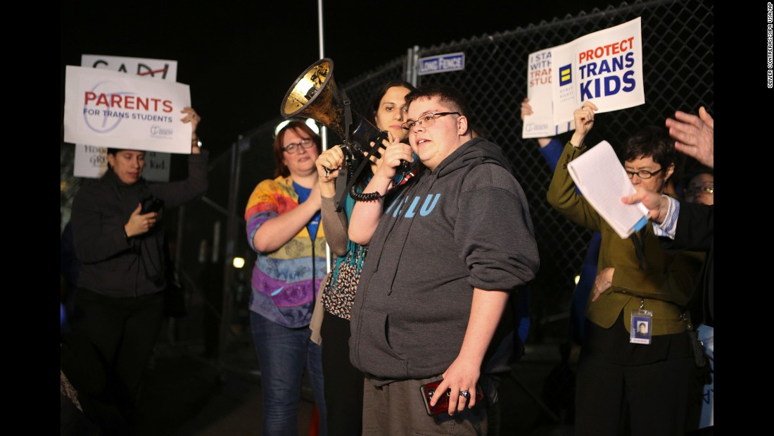 "Transgender teen Gavin Grimm, center, joins a protest outside the White House on Monday, February 20. Grimm is barred from using the boys' bathroom at his high school in Virginia. The Supreme Court is scheduled to hear arguments in <a href=""http://www.cnn.com/2017/02/23/politics/transgender-teen-supreme-court/"" target=""_blank"">his case</a> on March 28."