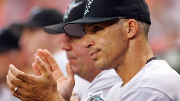 Manager Joe Girardi claps as the Marlins score four runs in the 2nd inning against the Washington Nationals on July 5, 2006, during his brief tenure in Florida.