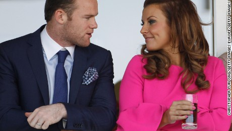 Rooney (left) with his wife Coleen.