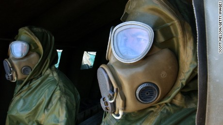 KUWAIT CITY, KUWAIT - DECEMBER 13: Czech soldiers in chemical protection suits take part in a chemical attack response drill conducted at the U.S. Embassy by civil defense authorities and troops from the United States, Germany, and Czech Republic December 13, 2002 in Kuwait City, Kuwait. The exercise, dubbed 'Event Horizon,' was staged to test the coordinated emergency response to a mock attack on the U.S. Embassy in Kuwait by terrorists using deadly sarin nerve gas.