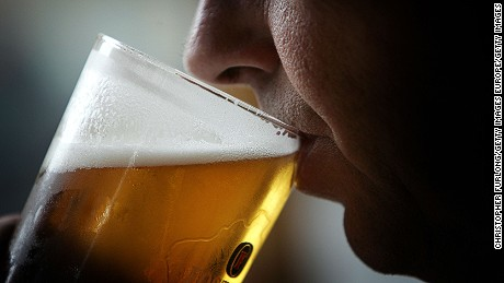 "GLASGOW, SCOTLAND - NOVEMBER 26:  A man drinks a pint of beer on November 26, 2004 in Glasgow, Scotland. The Scottish Executive has announced a major campaign designed to call time on the binge drinking culture which creates bad health and anti social behaviour. It is estimated that drink related problems cost the people of Scotland over GBP1bn a year.  Glasgow City Council has already banned ""happy hours"" where cut price drinks can be bought at specific times. (Photo illustration by Chris Furlong/Getty Images)"