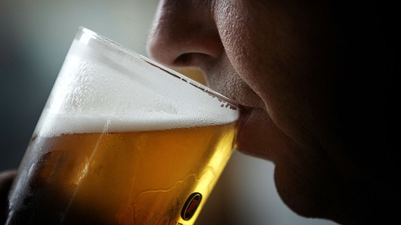 """GLASGOW, SCOTLAND - NOVEMBER 26:  A man drinks a pint of beer on November 26, 2004 in Glasgow, Scotland. The Scottish Executive has announced a major campaign designed to call time on the binge drinking culture which creates bad health and anti social behaviour. It is estimated that drink related problems cost the people of Scotland over GBP1bn a year.  Glasgow City Council has already banned """"happy hours"""" where cut price drinks can be bought at specific times. (Photo illustration by Chris Furlong/Getty Images)"""