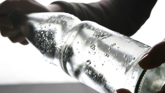 BERLIN - JANUARY 14: A bottle of carbonated mineral water is being shaken on January 14, 2007 in Berlin, Germany.  (Photo Illustration by Andreas Rentz/Getty Images)