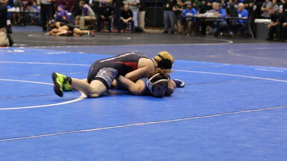 Transgender boy Mack Beggs, in red and black, was allowed to compete only against girls this year.
