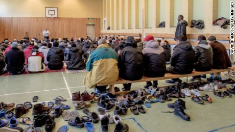 Refugees pray in the gym of the former psychiatric hospital Restad Farm in Vanersborg, Sweden, earlier this month.