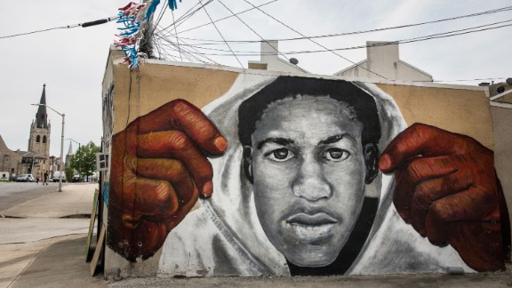 BALTIMORE, MD - APRIL 30:  A mural of Trayvon Martin is seen on the side of a building in the Sandtown neighborhood where Freddie Gray was arrested on April 30, 2015 in Baltimore, Maryland. Gray, 25, was arrested for possessing a switch blade knife April 12 outside the Gilmor Houses housing project on Baltimore