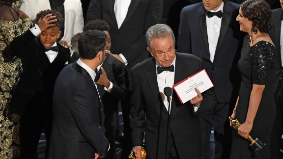 """The cast of """"Moonlight"""" and """"La La Land"""" appear on stage as presenter Warren Beatty shows the winner"""